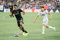 FOXBOROUGH, MA - AUGUST 4: Mark-Anthony Kaye #14 of Los Angeles FC advances towards goal with Carles Gil #22 of New England Revolution in pursuit during a game between Los Angeles FC and New England Revolution at Gillette Stadium on August 3, 2019 in Foxborough, Massachusetts.