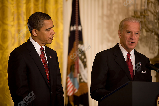 ©2008 David Burnett / Contact Press Images.January 30 2009.Washington DC.The White House.President Barack Obama  and  Vice President Joe Biden speak in East Room of The White House on formation of a Middle Class Panel..Obama signs 3 exec. orders.also present:.Senators: Debby Stabenow (Mich); Frank Lautenberg (NJ); Sherrod North (Ohio)..Econ. adviser Larry Summers.Peter Orszag - Office of Mgt. and Budget