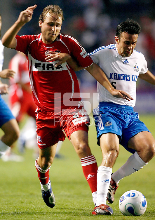 Kansas City Wizards midfielder Kerry Zavagnin (5) holds off Chicago Fire midfielder Justin Mapp (21).  The Chicago Fire defeated the Kansas City Wizards 2-1 at Toyota Park in Bridgeview, IL on April 21, 2007.