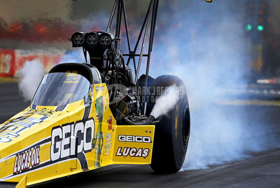 Aug. 31, 2013; Clermont, IN, USA: NHRA top fuel dragster driver Morgan Lucas during qualifying for the US Nationals at Lucas Oil Raceway. Mandatory Credit: Mark J. Rebilas-
