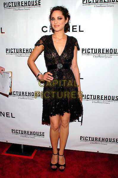 "MARION COTILLARD.Chanel and Picturehouse Screening of ""La Vie En Rose"" at the Paris Theater, New York City, New York, USA,.31 May 2007..full length hand on hip black dress sheer see through.CAP/ADM/BL.©Bill Lyons/AdMedia/Capital Pictures. *** Local Caption ***"