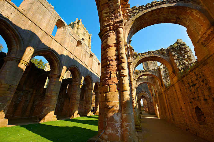 Main & side aisle of Fountains Abbey , founded in 1132, is one of the largest and best preserved ruined Cistercian monasteries in England. The ruined monastery is a focal point of England's most important 18th century Water, the Studley Royal Water Garden which is a UNESCO World Heritage Site. Near Ripon, North Yorkshire, England