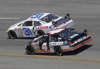 May 6, 2007; Richmond, VA, USA; Nascar Nextel Cup Series driver Jeff Burton (31) leads brother Ward Burton (4) during the Jim Stewart 400 at Richmond International Raceway. Mandatory Credit: Mark J. Rebilas