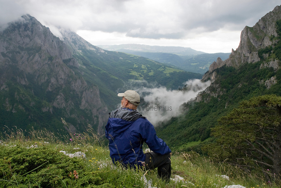A hiker rests below Ugljesin peak in Sutjeska National Park, one of the oldest parks in Bosnia and Herzegovina. Sutjeska National Park used to be a popular youth group destination prior to the fragmentation of Yugoslavia. Now, it gets very few visitors, providing solitude that is rare among European mountain areas.