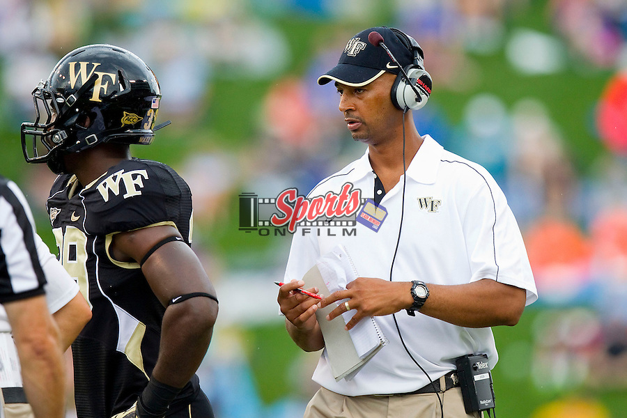 Wake Forest Demon Deacons linebackers coach Derrick Jackson during a timeout in the game against the North Carolina Tar Heels at BB&T Field on September 8, 2012 in Winston-Salem, North Carolina.  The Demon Deacons defeated the Tar Heels 28-27.  (Brian Westerholt/Sports On Film)