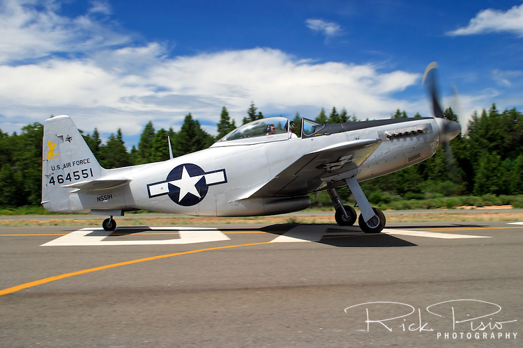 A rare North American P-51H taxies across the ramp during a fly-in at the Nevada County Airport in 2005. The P-51 Mustang is considered to be the premier fighter of the World War II and many are kept in flying condition by their civilian owners.