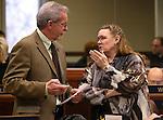 Nevada Assemblywoman Maggie Carlton, D-Las Vegas, talks with Assemblyman Glenn Trowbridge, R-Las Vegas, on the Assembly floor at the Legislative Building in Carson City, Nev., on Friday, Feb. 13, 2015. <br /> Photo by Cathleen Allison