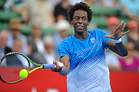 MELBOURNE, 12 JANUARY - Gael Monfils (FRA) hits a forehand in a match against Fernando Verdasco (ESP) on day one of the 2011 AAMI Classic at Kooyong Tennis Club in Melbourne, Australia. (Photo Sydney Low / syd-low.com)