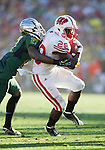 Wisconsin Badgers running back Montee Ball (28) is tackled by Oregon Ducks defensive back Terrance Mitchell (27) during the 2012 Rose Bowl NCAA football game in Pasadena, California on January 2, 2012. The Ducks won 45-38. (Photo by David Stluka)