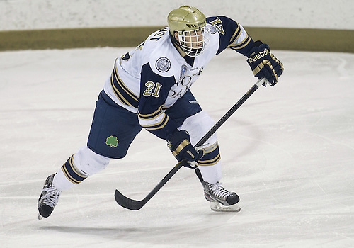 December 07, 2012:  Notre Dame right wing Bryan Rust (#21) during NCAA Hockey game action between the Notre Dame Fighting Irish and the Michigan State Spartans at Compton Family Ice Arena in South Bend, Indiana.  Notre Dame defeated Michigan State 3-2.