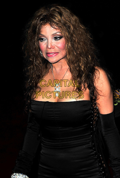 "LA TOYA JACKSON.The UK Premiere of ""The Imaginarium Of Doctor Parnassus"" at the Empire Leicester Square, London, England..October 6th 2009.Latoya half length black lace-up sides corset dress silver diamond bracelets sleeves arm warmers necklace.CAP/CJ.©Chris Joseph/Capital Pictures."
