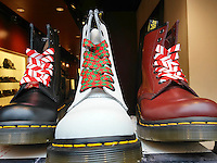 A display of Dr. Martens shoes showing their Christmas spirit in the window of a Dr. Martens store in New York on Saturday, November 26, 2016,   (© Richard B. Levine)