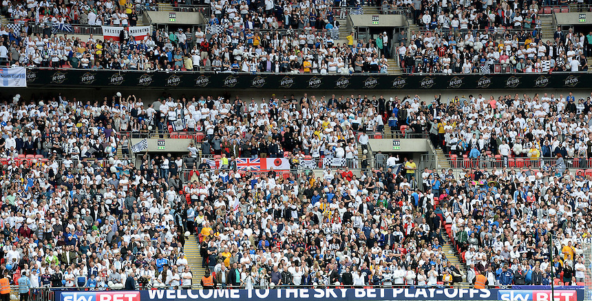 Preston North End fans enjoy the atmosphere prior to kick off<br /> <br /> Photographer Ian Cook/CameraSport<br /> <br /> Football - The Football League Sky Bet League One Play-Off Final - Preston North End v Swindon Town - Sunday 24th May 2015 - Wembley Stradium - London<br /> <br /> &copy; CameraSport - 43 Linden Ave. Countesthorpe. Leicester. England. LE8 5PG - Tel: +44 (0) 116 277 4147 - admin@camerasport.com - www.camerasport.com
