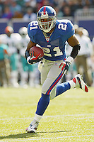 Tiki barber In an NFL game played at Giants Stadium between the Miami Dolphins and the New York Giants