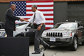 United States President Barack Obama (C) is welcomed to the stage by Transportation Secretary Anthony Foxx at the The Federal Highway Administration's Turner-Fairbank Highway Research Center July 15, 2014 in McLean, Virginia. According to the Department of Transportation, the center is home to '20 laboratories, data centers, and support facilities, and conducts applied and exploratory advanced research in vehicle-highway interaction, nanotechnology, and a host of other types of transportation research in safety, pavements, highway structures and bridges, human-centered systems, operations and intelligent transportation systems, and materials.'  <br /> Credit: Chip Somodevilla / Pool via CNP
