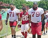 Washington Redskins offensive tackle Trent Williams (71), cornerback Bashaud Breeland (26), and offensive tackle Ty Nsekhe (79) leave the field following an organized team activity (OTA) at Redskins Park in Ashburn, Virginia on Wednesday, June 1, 2016.<br /> Credit: Ron Sachs / CNP