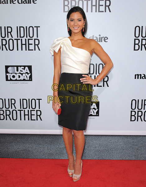 "Olivia Munn.""Our Idiot Brother"" Los Angeles Premiere held at Arclight Cinemas, Hollywood, California, USA..August 16th, 2011.full length white one shoulder top black skirt hand on hip beige peep toe shoes .CAP/RKE/DVS.©DVS/RockinExposures/Capital Pictures."