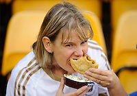 A Swansea City fan enjoying a pie during the Barclays Premier League match between Norwich City and Swansea City played at Carrow Road, Norwich on November 6th 2015