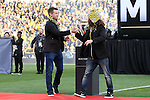 06 December 2015: Columbus Crew legends Brian McBride (left) and Frankie Hejduk (right) carry the Philip F. Anschutz Trophy onto the field before the game. The Columbus Crew SC hosted the Portland Timbers FC at Mapfre Stadium in Columbus, Ohio in MLS Cup 2015, Major League Soccer's championship game. Portland won the game 2-1.