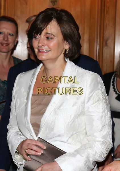 CHERIE BLAIR .At the Woman of Substance Awards, The Dorchester Hotel, London, England, UK, September 10th 2009..half length blazer jacket beige top white fringe gold earrings Booth clutch bag profile .CAP/MAR.©Martin Harris/Capital Pictures