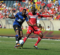 Manchester United forward Danny Welbeck (19) shoots the ball while being pressured by Chicago Fire defender Yamith Cuesta (89).  Manchester United defeated the Chicago Fire 3-1 at Soldier Field in Chicago, IL on July 23, 2011.
