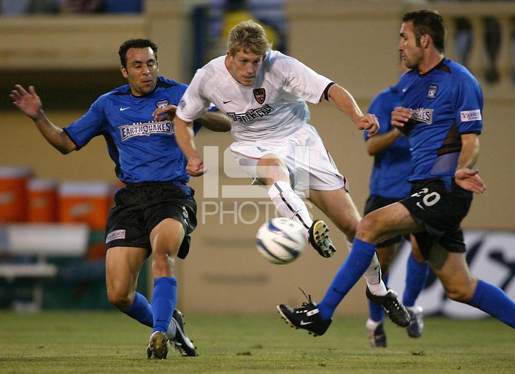 12 June 2004: MetroStars John Wolyniec kicks the ball between Earthquakes Ryan Cochrane and Ramiro Corrales at Spartan Stadium in San Jose, California.    Earthquakes defeated MetroStars, 3-1.   Mandatory Credit: Michael Pimentel / ISI