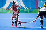 Michelle Vittese #9 of United States tries to get passed two defenders during USA vs Germany in a women's quarterfinal game at the Rio 2016 Olympics at the Olympic Hockey Centre in Rio de Janeiro, Brazil.
