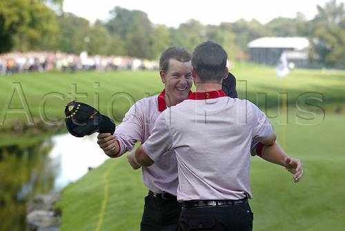 24 September 2006: European players Henrik Stenson and Paul Casey celebrate winning on the 16th green on the final day of The 2006 Ryder Cup played at The K Club, Straffan, County Kildare, Ireland. Stenson holed the putt which secured the Cup, Europe beat USA 18 1/2 to 9 1/2 Photo: Glyn Kirk/Actionplus..060924 golf golfers joy celebrate celebration