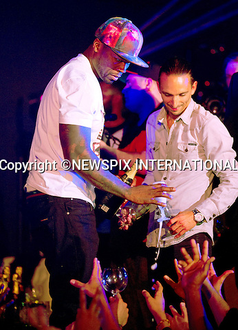 """EXCLUSIVE!.""""Must telephone +441279 324672 For Reproduction Fees/Usage"""".50 CENT -  FREE MOET ALL ROUND..Mandatory Credit Photos: ©NEWSPIX INTERNATIONAL..**ALL FEES PAYABLE TO: """"NEWSPIX INTERNATIONAL""""**..PHOTO CREDIT MANDATORY!!: NEWSPIX INTERNATIONAL(Failure to credit will incur a surcharge of 100% of reproduction fees)..IMMEDIATE CONFIRMATION OF USAGE REQUIRED:.Newspix International, 31 Chinnery Hill, Bishop's Stortford, ENGLAND CM23 3PS.Tel:+441279 324672  ; Fax: +441279656877.Mobile:  0777568 1153.e-mail: info@newspixinternational.co.uk"""