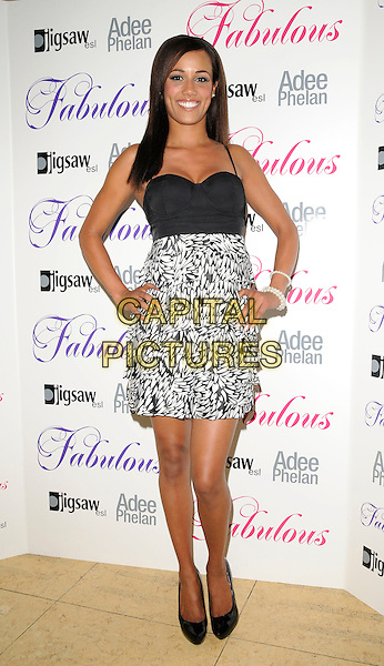 NOIRIN KELLY.Attending the 'Fabulous' Haircare Range Launch Party, Frankie's Italian Bar & Grill, Yeomans Row, London, England, .25th August 2009..full length black bustier top dress and white print high waisted hands on hips shoes heels patent platform .CAP/CAN.©Can Nguyen/Capital Pictures.