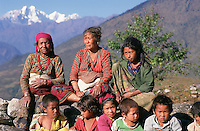 Some women take a rest with their children after a long day's work on their farms. They live in the foothills of the Himalayas near Pangtang in central northern Nepal and their farms are a series of tiny terraces clinging to the steep slopes.
