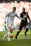 Cristiano Ronaldo (l) of Real Madrid competes for the ball with Ruben Miguel Nunes Vezo of Granada CF during their La Liga match between Real Madrid and Granada CF at the Santiago Bernabeu Stadium on 07 January 2017 in Madrid, Spain. Photo by Diego Gonzalez Souto / Power Sport Images