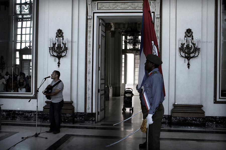 Havana (Cuba). September 2006..La Habana Vieja. Museum of the Revolution, former Presidential Palace. Ceremony to bestow a medal to the most relevant members of the CDRs (Comités de Defensa de la Revolución/ Committees for the Defense of the Revolution), in their 46th anniversary (The CDR system was formed on September 28, 1960 by Fidel Castro)..