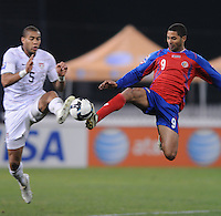 USMNT defender Oguchi Onyewu (5) jumps to control the ball against Costa Rica forward Alvoro Saborio.  The USMNT tied Costa Rica 2-2 on the final game of the 2010 FIFA World Cup Qualifying round at RFK Stadium, Wednesday October 14, 2009.