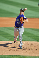 Albuquerque Isotopes starting pitcher Chi Chi Gonzalez (24) throws to the plate in the game against the Salt Lake Bees at Smith's Ballpark on April 27, 2019 in Salt Lake City, Utah. The Isotopes defeated the Bees 10-7. This was a makeup game from April 26, 2019 that was cancelled due to rain. (Stephen Smith/Four Seam Images)