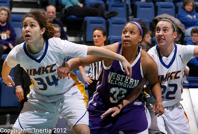 SIOUX FALLS, SD - MARCH 5:  Hailey Houser #34 (left) and Brianna Eldridge #22 from UMKC (right) try for rebounding position with Brittany Demery #32 from Western Illinois University during the second half of their semifinal game Monday afternoon at the 2012 Summit League Tournament at the Sioux Falls Arena.  (Photo by Dick Carlson/Inertia)