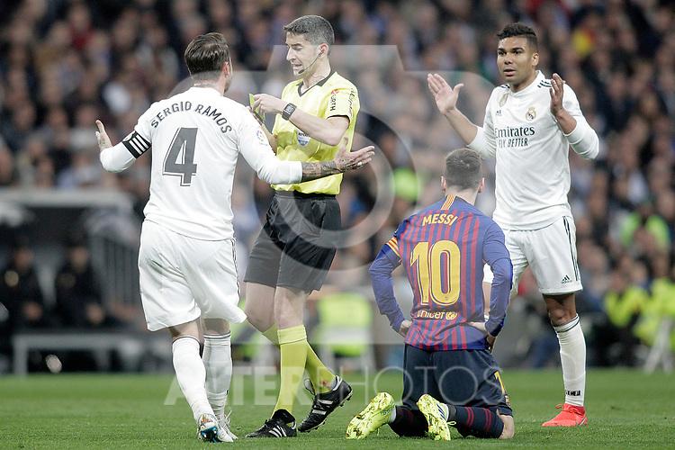 Referee Undiano Mallenci shows yellow card to Real Madrid CF's Sergio Ramos during La Liga match. March 02,2019. (ALTERPHOTOS/Alconada)