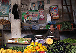 Palestinian vendors sell vegetables and fruits on the fourth day of the Muslim fasting month of Ramadan on July 13, 2013 in Gaza city. During Ramadan, one of the five main religious obligations under Islam, Muslims are required to abstain from food and from drinking liquids, smoking and having sex from dawn until dusk. Photo by Ashraf Amra