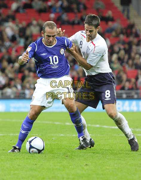 PAOLO DI CANIO & JAMIE REDKNAPP.Soccer Aid - a Charity Soccer match in aid of Unicef played at Wembley Stadium, London, England..September 7th, 2008.full length football sport kit uniform white top black shorts socks kicking blue jaime pushing shoving .CAP/ROS.©Steve Ross/Capital Pictures.