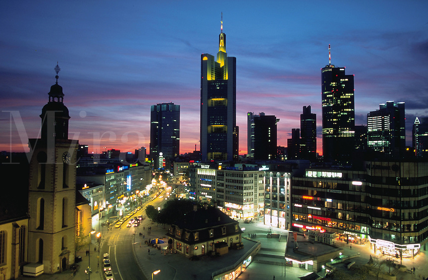 Scenic aerial skyline of the city of Frankfurt, skyscraper buildings and lights in the financial district at twilight. Frankfurt, Germany.