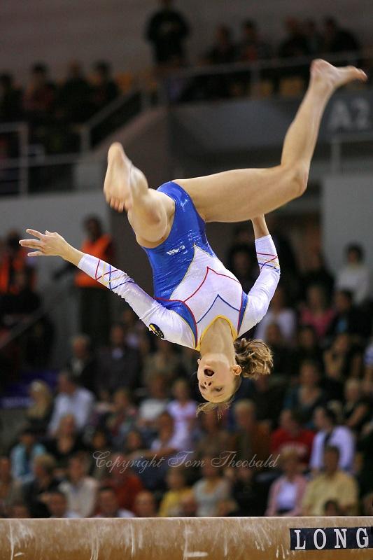 Oct 18, 2006; Aarhus, Denmark;  Sandra Izbasa of Romania performs on balance beam during women's team final at 2006 World Championships Artistic Gymnastics.