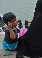 Muslim women and children at the River Ganges Varanasi India