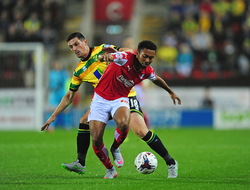 Rotherham United's Grant Ward is fouled by Norwich City's Graham Dorrans<br /> <br /> Photographer Chris Vaughan/CameraSport<br /> <br /> Football - Capital One Cup Second Round - Rotherham United v Norwich - Tuesday 25th August 2015 - New York Stadium - Rotherham<br />  <br /> &copy; CameraSport - 43 Linden Ave. Countesthorpe. Leicester. England. LE8 5PG - Tel: +44 (0) 116 277 4147 - admin@camerasport.com - www.camerasport.com