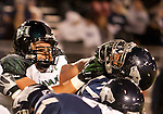 November 12, 2011:Hawaii linemen Geordon Hanohano, left, battles with the Nevada line during a WAC league game played at Mackay Stadium in Reno, Nevada.