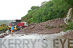 A land slide at Mountain Stage, Kells caused major road disruption on Sunday blocking Ring of Kerry road access from just before 4:30pm to 9:30pm.  Pictured here County Council workers clearing the 300 tons of rock and gravel that heavy rain brought down the mountain.