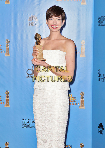 Anne Hathaway.Press Room at the 70th Annual Golden Globe Awards held at the Beverly Hilton Hotel, Hollywood, California, USA..January 13th, 2013.globes half length dress strapless white smiling 3/4 award trophy winner  beads beaded peplum.CAP/ADM/SLP/COL.©Collin/Starlitepics/AdMedia/Capital Pictures.