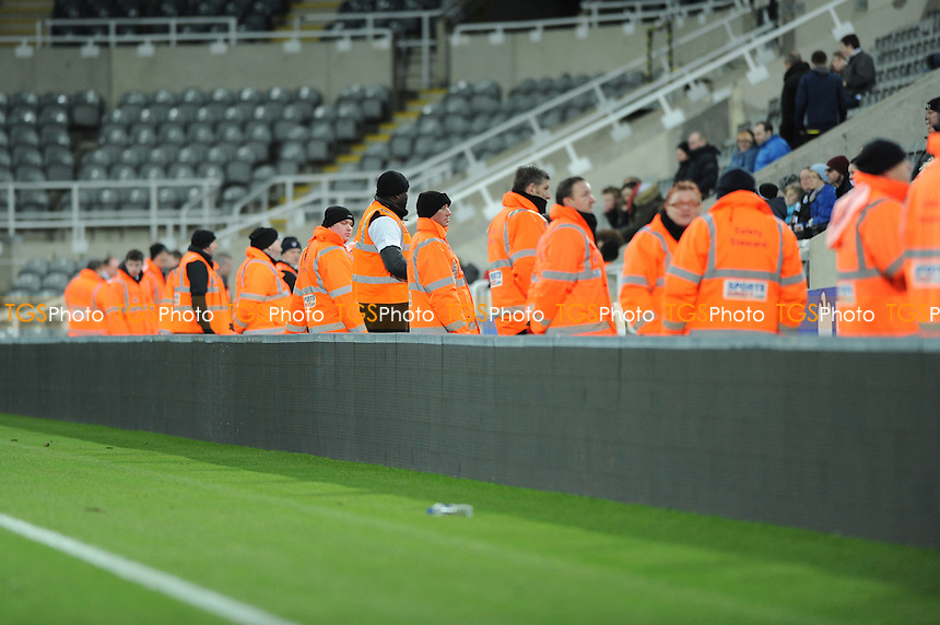 Stewards stand in front of the boards after two fans get onto the pitch - Newcastle United Under-21 vs Arsenal Under-21 - Barclays Under-21 Premier League Football at St James Park, Newcastle United FC - 09/02/15 - MANDATORY CREDIT: Steven White/TGSPHOTO - Self billing applies where appropriate - contact@tgsphoto.co.uk - NO UNPAID USE