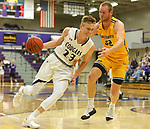 SIOUX FALLS, SD - DECEMBER 7: Drew Guebert #23 from the University of Sioux Falls gets a step past Max Keefe #32 from Concordia St. Paul during their game Friday night at the Stewart Center in Sioux Falls, SD. (Photo by Dave Eggen/Inertia)