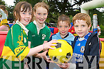 SOAKED: Having a great time playing football in the rain at Tralee town park on Friday.from l-r were: Aoife Mahony, Muireann McKenna, Barry Mahony and Jack McKenna.