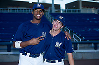 AZL Brewers Ernesto Wilson Martinez (56) and Brent Diaz (28) pose for a photo before a game against the AZL Cubs on August 24, 2017 at Maryvale Baseball Park in Phoenix, Arizona. AZL Cubs defeated the AZL Brewers 9-1. (Zachary Lucy/Four Seam Images)